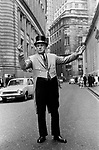Door man at the Bank of England, directing traffic into the buildings car park. 1970s London. UK