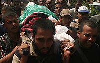 """Palestinians carry the body of Emad Abu Ahjayer,  Leader of Alqassam Brigads loyal Hamas movement during his funeral in the Bureij refugee camp, central Gaza Strip, Thursday, Sept. 21, 2007. Israeli troops operating against rocket squads in Gaza .""""photo by Fday Adwan"""""""