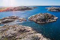 Aerial view of two sea kayakers, Markus and Ingela Holgersson paddling outside of Grönemad, Grebbestad, West Sweden.