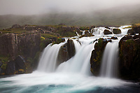 Dynjandisa River falls over Baejarfoss (Sjoarfoss) waterfall, West Iceland, Iceland