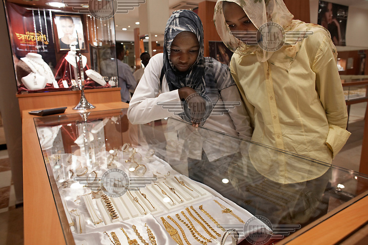 Young women in a jewellery store. Khartoum's first mall 'Afra' opened in 2004 and has become popular with affluent Sudanese.