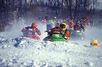 snowmobile, winter, racing, Waitsfield, VT, Vermont, Two racers approaching a curve in the Snowmobile Race at the Mad River Valley Winter Carnival in Waitsfield in winter.