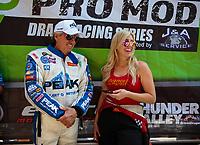 Jun 17, 2018; Bristol, TN, USA; NHRA funny car driver John Force (left) with daughter Courtney Force during the Thunder Valley Nationals at Bristol Dragway. Mandatory Credit: Mark J. Rebilas-USA TODAY Sports