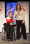 Calgary, AB - June 5 2014 - Graeme Murray receives his Paralympic ring from Erin Kelly, of Suncor/Petro-Canada, during the Celebration of Excellence Paralympic Ring Reception in Calgary. (Photo: Matthew Murnaghan/Canadian Paralympic Committee)