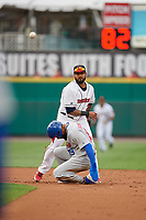 Rochester Red Wings shortstop Jordany Valdespin (23) throws to first base as Teoscar Hernández (19) slides in during an International League game against the Buffalo Bisons on May 31, 2019 at Frontier Field in Rochester, New York.  Rochester defeated Buffalo 5-4 in ten innings.  (Mike Janes/Four Seam Images)