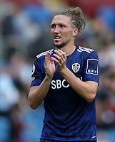 29th August 2021; Turf Moor, Burnley, Lancashire, England; Premier League football, Burnley versus Leeds United: Luke Ayling of Leeds United applauds the visiting supporters at the final whistle