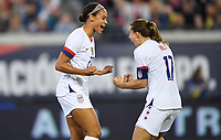 JACKSONVILLE, FL - NOVEMBER 10: Lynn Williams #27 and Tobin Heath #17 of the United States celebrate a Lynn Williams goal during a game between Costa Rica and USWNT at TIAA Bank Field on November 10, 2019 in Jacksonville, Florida.