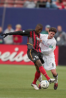 The MetroStars' Cornell Glen battles for the ball with New England Revolution's Jay Heaps. The New England Revolution played the NY/NJ MetroStars to a 1 to 1 tie at Giant's Stadium, East Rutherford, NJ, on April 25, 2004.