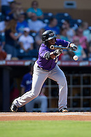 Irving Falu (4) of the Louisville Bats lays down a bunt against the Durham Bulls at Durham Bulls Athletic Park on August 9, 2015 in Durham, North Carolina.  The Bulls defeated the Bats 9-0.  (Brian Westerholt/Four Seam Images)