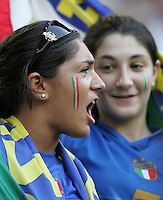 An Italian fan yells to her team as they take the field.  Italy defeated Germany, 2-0, in overtime in their FIFA World Cup semifinal match at FIFA World Cup Stadium in Dortmund, Germany, July 4, 2006.