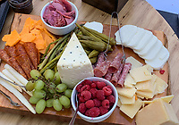 Appetizer Board at a Buffet.  Cheeses, Raspberries, Grapes, Ham.