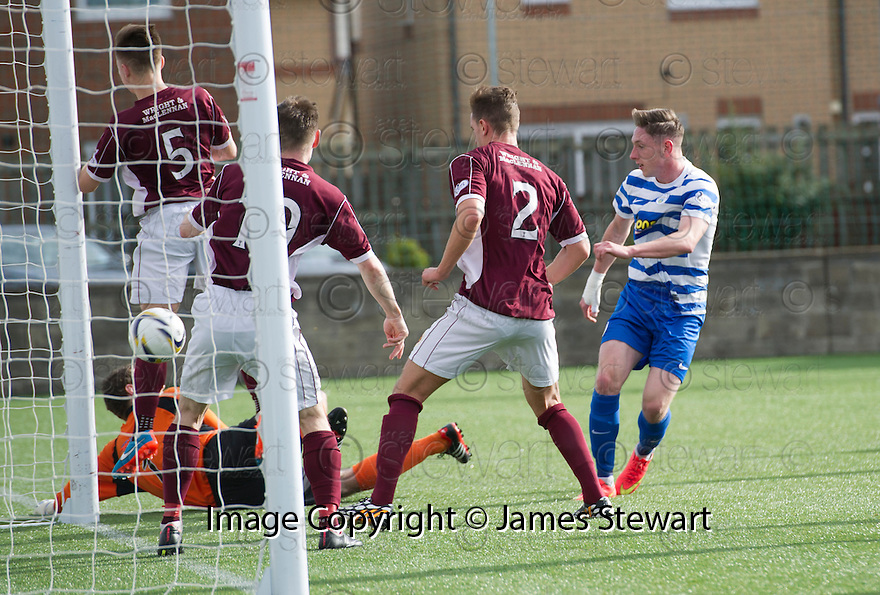Morton's Declan McManus scores their first goal.