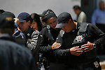 A ceremony to salute the fallen municipal police officer,  22-year-old Ada Agustina Nevárez Soto who was killed in an ambush on April 23, 2010 in Ciudad Juarez, were held at the Benito Juarez District headquarters on Monday, April 6, 2010. She lost her life along with 6 other elements of the fedral police. She was laid to rest at the San Rafael cemetery in Ciudad Juarez in the company of her family, friends and co-workers. The perimeter of the cemetery was secured by several municipal and federal police officers as they stood guard in case of a possible attack during these final moments. ..©Javier Manzano