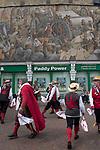 Dartford Kent, Morris dancers dancing under wall art mural depicting heritage trades of this town. 2019 UK
