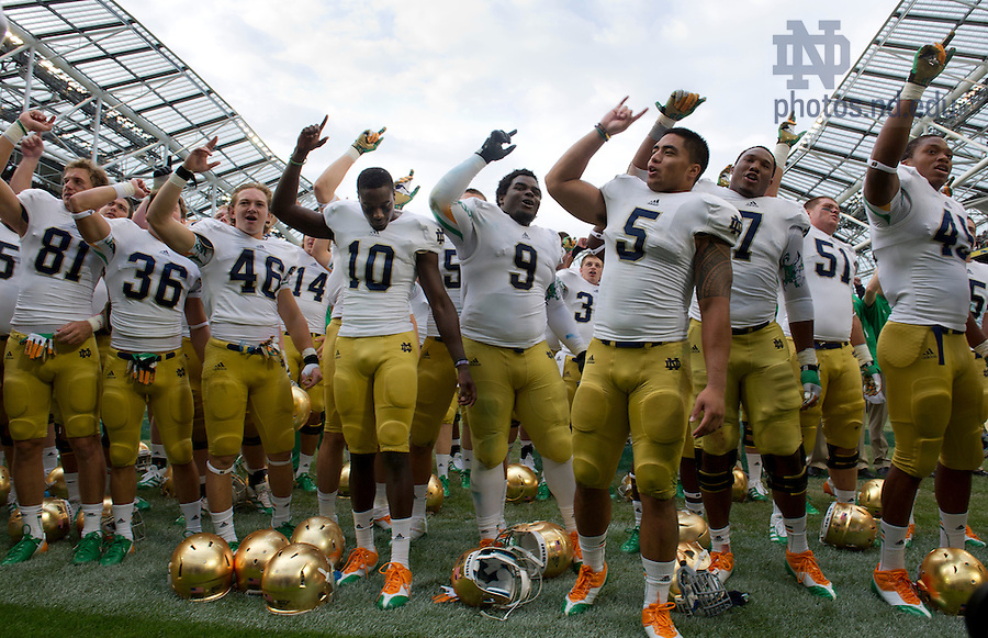 Sept. 1, 2012; Notre Dame linebacker Manti Te'o celebrates  with teammates after Notre Dame defeated the Navy Midshipmen 50 to 10, in the 2012 Emerald Isle Classic at Aviva Stadium in Dublin, Ireland. Photo by Barbara Johnston/University of Notre Dame