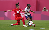 KASHIMA, JAPAN - AUGUST 2: Crystal Dunn #2 of the United States battles for the ball with Jessie Fleming #17 of Canada during a game between Canada and USWNT at Kashima Soccer Stadium on August 2, 2021 in Kashima, Japan.