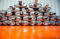 Stack of Car Exhausts on an orange floor