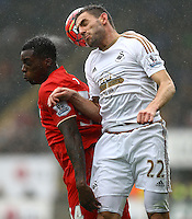 Sheyi Ojo of Liverpool and Angel Rangel of Swansea City in action during the Barclays Premier League match between Swansea City and Liverpool played at the Liberty Stadium, Swansea on 1st May 2016