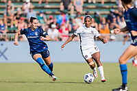 CARY, NC - SEPTEMBER 12: Kaleigh Kurtz #3 of the NC Courage defends against Crystal  Dunn #19 of the Portland Thorns during a game between Portland Thorns FC and North Carolina Courage at Sahlen's Stadium at WakeMed Soccer Park on September 12, 2021 in Cary, North Carolina.