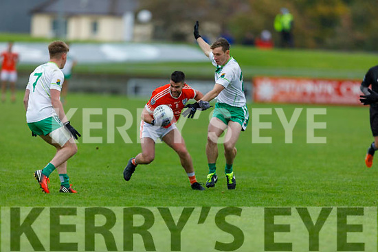 Mike Finnegan of Brosna tries to get past Brendán<br /> O'Neill and Tommy Kennelly of Ballydonoghue's in the Premier Junior Football Championship Semi-Final