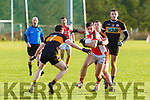 Aidan O'Mahony Rathmore goes through the Stacks defence during the County League final in Rathmore on Sunday