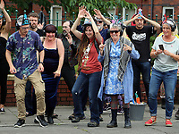 Pictured: Deidre Murphy. Sunday 16 July 2017<br /> Re: A team of highly trained Levitators harness their psychic forces to raise The Palace Theatre on the High Street in Swansea, south Wales, as part of the Troublemakers Festival.<br /> The theatre was built in 1888 as a traditional music hall, named originally the 'Pavilion'. During its lifetime, the building has been used as a bingo hall as well as a gay nightclub.<br /> The Grade II Listed building is one of just two purpose-built music halls left standing in the whole of the UK.<br /> In the early years of the 20th century stars like Charlie Chaplin, Lilly Langtry, Marie Lloyd and Dan Leno filled the venue.<br /> Sir Anthony Hopkins made his first professional stage appearance there in 1960 with Swansea Little Theatre's production of 'Have A Cigarette'.<br /> Also in the early 1960s, Morecambe and Wise were booked. Ken Dodd was the last stand-up comedian to appear there before it became nightclub in the 1970s.<br /> It was also the first place in Wales to show a silent picture and remained undamaged by the blitz that destroyed much of Swansea city centre during the Second World War.<br /> Eventually the theatre was sold for £300,000 to a property company, but in 2010 it was still derelict and actor Edward Fox joined a campaign to have it restored.