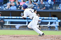 Asheville Tourists right fielder Sam Hilliard (25) runs to first base during a game against the Augusta GreenJackets at McCormick Field on August 5, 2016 in Asheville, North Carolina. The Tourists defeated the GreenJackets 7-6. (Tony Farlow/Four Seam Images)
