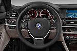 Steering wheel view of a 2013 Bmw SERIES 5 ActiveHybrid 5 4 Door Sedan 2WD