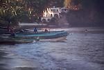 Mexico, Bahia Tenacatita; Fishermen with beached pangas (boats) at La Manzanilla; south of Puerto Vallarta; Jalisco;
