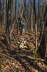Crossbow hunter approaches his kill in northern Wisconsin.