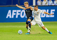CARSON, CA - OCTOBER 14: Jackson Yueill #14 of the San Jose Earthquakes battles with Perry Kitchen #2  of Los Angeles Galaxy during a game between San Jose Earthquakes and Los Angeles Galaxy at Dignity Heath Sports Park on October 14, 2020 in Carson, California.