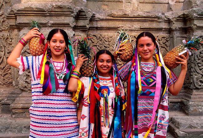 Mexican girls holding pineapples, participants in a Guelaguetza Festival Procession, Oaxaca, Oaxaca State, Mexico, North America