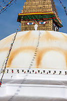 Bodhnath, Nepal.  The All-Seeing Eyes of the Buddha Gaze out from above the Stupa of Bodhnath, a center of Tibetan Buddhism, near Kathmandu.   The stupa survived the earthquale of April 2015.