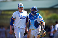 South Dakota State Jackrabbits starting pitcher Tyler Olmstead (28) and catcher Derek Hackman (9) during a game against the FIU Panthers on February 23, 2019 at North Charlotte Regional Park in Port Charlotte, Florida.  South Dakota State defeated FIU 4-3.  (Mike Janes/Four Seam Images)