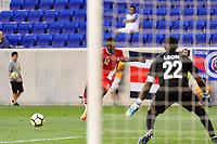 Harrison, NJ - Friday July 07, 2017: Alphonso Davies, Donovan Leon during a 2017 CONCACAF Gold Cup Group A match between the men's national teams of French Guiana (GUF) and Canada (CAN) at Red Bull Arena.