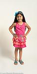Portrait of 5 year old girl, standing, full length