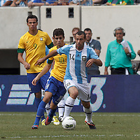 Argentina midfielder Javier Mascherano (14) brings the ball forward as Brazil midfielder Oscar (10) closes. In an international friendly (Clash of Titans), Argentina defeated Brazil, 4-3, at MetLife Stadium on June 9, 2012.