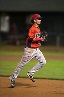 Orem Owlz center fielder Rayneldy Rosario (12) jogs off the field between innings of a Pioneer League game against the Helena Brewers at Kindrick Legion Field on August 21, 2018 in Helena, Montana. The Orem Owlz defeated the Helena Brewers by a score of 6-0. (Zachary Lucy/Four Seam Images)
