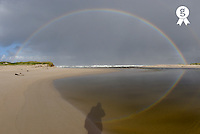 Shadow of person taking photograph of rainbow at beach (Licence this image exclusively with Getty: http://www.gettyimages.com/detail/200482555-001 )