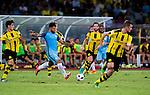 SHENZHEN - JULY 28: Manchester City striker Sergio Aguero (c) in action during the match between Borussia Dortmund vs Manchester City FC at the 2016 International Champions Cup China match at the Shenzhen Stadium on 28 July 2016 in Shenzhen, China. (Photo by Power Sport Images/Getty Images)