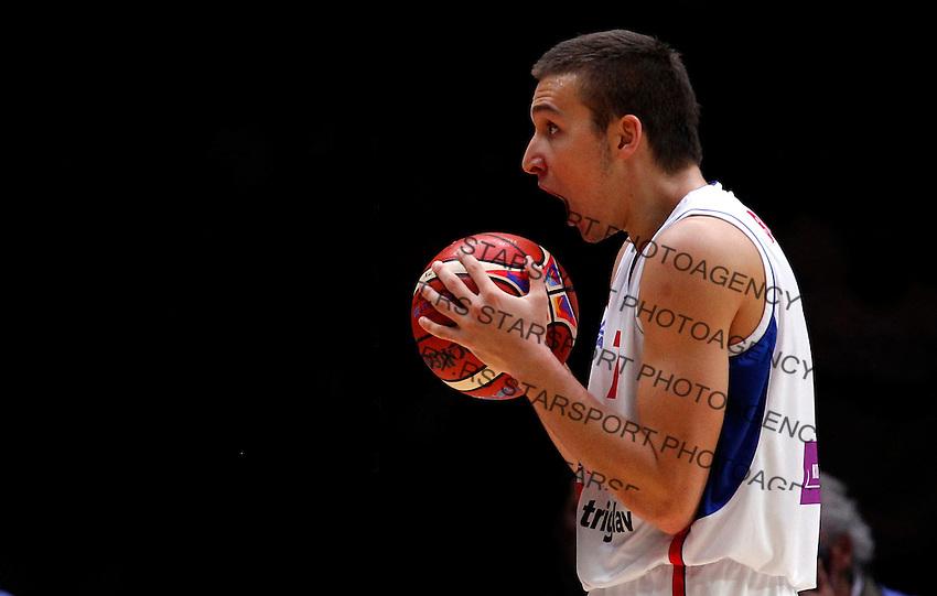 Serbia's Bogdan Bogdanovic reacts during European championship semi-final basketball match between Serbia and Lithuania on September 18, 2015 in Lille, France  (credit image & photo: Pedja Milosavljevic / STARSPORT)