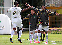 BOGOTA -COLOMBIA, 27 -SEPTIEMBRE-2014. Jose Moreno (De espaldas)  de La Equidad   celebra su gol contra  el Atletico Huila durante partido de la  doceava fecha  de La Liga Postob—n 2014-2. Estadio Metroplitano de Techo . / Jose Moreno  (back) of Equidad celbrates his goal against Atletico Huila  during 12th date  game of the La Liga Postob—n date 2014-2. Metropolitano de Techo  Stadium . Photo: VizzorImage / Cristian Alvarez  / Contribuidor
