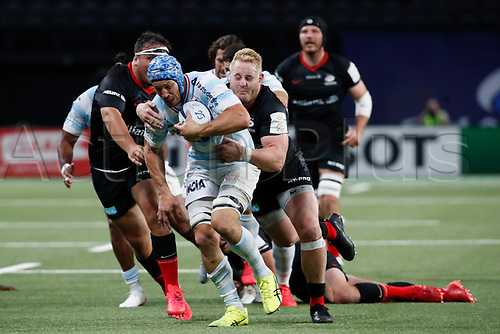 26th September 2020, Paris La Défense Arena, Paris, France; Champions Cup rugby semi-final, Racing 92 versus Saracens; Lauret (Racing 92) tackled by Koch (Saracens)