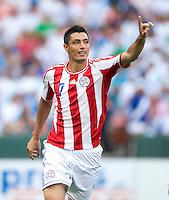 Oscar Cardozo (7) of Paraguay celebrates his goal during the game at RFK Stadium in Washington, DC.  Guatemala tied Paraguay, 3-3.