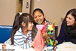 Mother and preschool age daughter participating in parent skills training course offered by Headstart site to assist parents and families