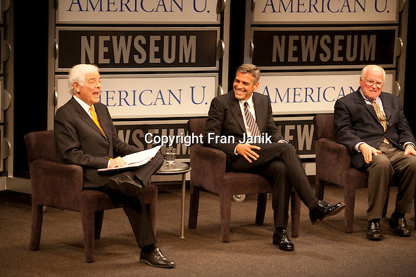 """Journalist Nick Clooney and his son the actor George Clooney share a light moment with fellow guest Bill Small (at right) on stage at the Newseum in Washinton, D.C. during the production of a segment of """"reel journalism"""" discussion of the film """"Good Night and Good Luck"""" in 2012"""