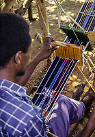 Korhogo, Ivory Coast, Cote d'Ivoire.  Senoufo Male Weaver at Work.