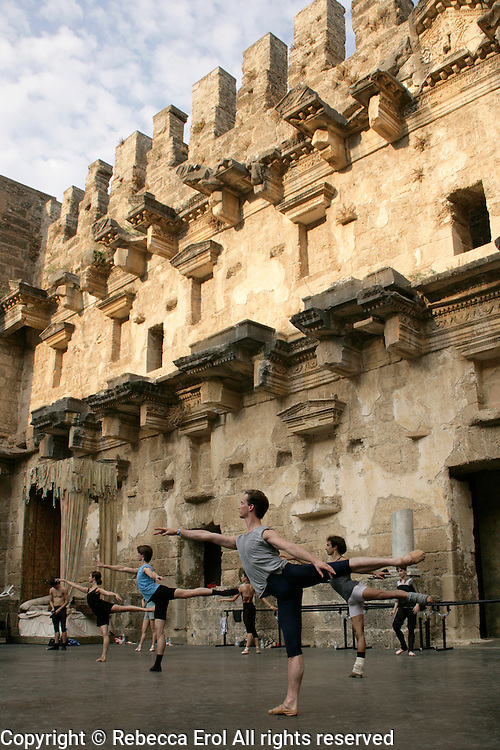 Male dancers of The Royal Ballet, Covent Garden, take class on the stage of the open-air Aspendos Theatre in Antalya, Turkey