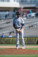 Salt River Rafters relief pitcher Justin Lawrence (61), of the Colorado Rockies organization, gets ready to deliver a pitch during an Arizona Fall League game against the Surprise Saguaros on October 9, 2018 at Surprise Stadium in Surprise, Arizona. The Rafters defeated the Saguaros 10-8. (Zachary Lucy/Four Seam Images)