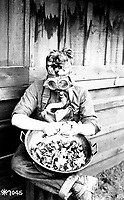 Soldiers trying out their gas masks in ever possible way.  Putting the respirator to good use while peeling onions.  40th Div., Camp Kearny, San Diego, Calif.  March 1918.  Lt. E.N. Jackson.  (Army)<br /> Exact Date Shot Unknown<br /> NARA FILE #:  111-SC-7045<br /> WAR & CONFLICT BOOK #:  454